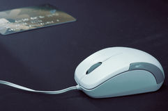 Closeup mouse with blur credit card in blue color style Royalty Free Stock Photography