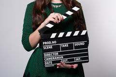 Closeup of a movie clapper keeps the girl in the green dress Royalty Free Stock Photo