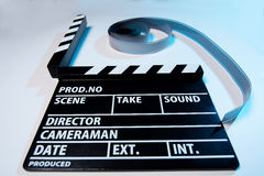 Closeup of a movie clapper and video film movie on a light backg Royalty Free Stock Images