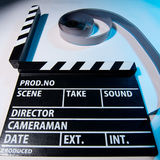 Closeup of a movie clapper and video film movie on a light backg Stock Photo