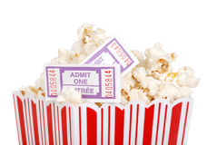 Closeup movie tickets in popcorn. Isolated closeup movie tickets in popcorn on white background Royalty Free Stock Image