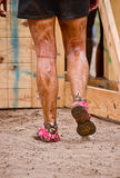 Closeup of mud race runner's muddy legs Royalty Free Stock Image
