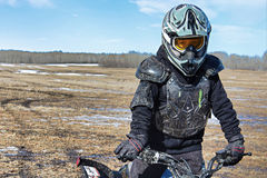 Closeup of a muddy boy in bike protection gear Stock Photography