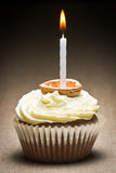Closeup muffin with candle Stock Photography