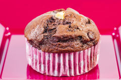 Closeup of a muffin on a red plate Stock Photo