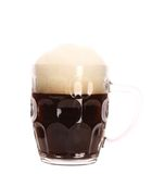Closeup of mug full with brown beer. Stock Images