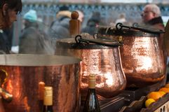 Closeup of mulled wine in traditional copper cauldron at the christmas market royalty free stock image
