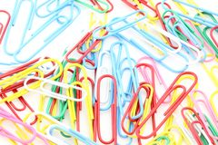 Closeup of multi-colored paper clips background Stock Photos