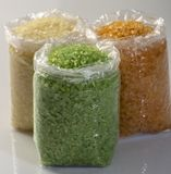 Closeup of Multicolored sea salt in plastic bags on the market. Close up royalty free stock photo