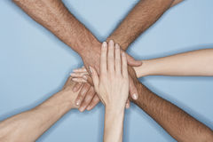 Closeup Of Multiethnic Hands On Top Of Each Other Royalty Free Stock Images