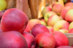 Closeup of multiple red apples for sale at an outdoor market Stock Photo