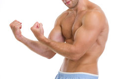 Closeup on muscular man showing biceps Stock Image