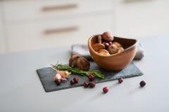 Closeup on mushrooms lingonberries and rosmarinus Royalty Free Stock Image