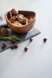 Closeup on mushrooms lingonberries and rosmarinus on table Stock Photos