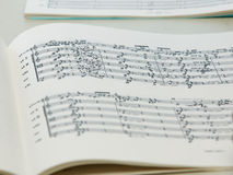 Closeup on a musicbook with notes.JH. Notes in an music book.JH royalty free stock photos