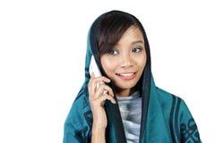 Closeup of muslim woman using cellphone Royalty Free Stock Photo