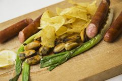 Closeup of Mussels, sausages and fries Stock Image