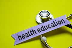 Closeup My health with stethoscope concept inspiration on yellow backgroundCloseup health education with stethoscope concept inspi. Closeup health education with royalty free stock photo