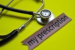Closeup my prescription with stethoscope concept inspiration on yellow background stock image