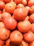 Closeup mycket av ny orange bakgrund/textur Fotografering för Bildbyråer