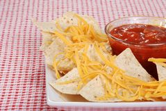 Closeup nachos and cheese focus on salsa Royalty Free Stock Photos