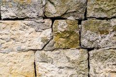 Closeup nafragment wall of chipped stone, rock walls, overgrown Royalty Free Stock Photo