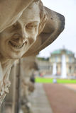 Closeup naked satyr smiling statue crop with fountain and garden Royalty Free Stock Photography