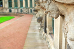 Closeup naked satyr smiling statue crop at Zwinger palace in Dre Royalty Free Stock Photo
