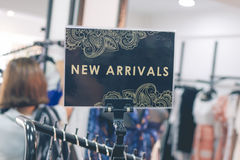 Closeup a nameplate with text new arrivals in the modern shop. Bali island. Stock Images