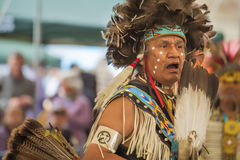 Closeup of Native American chanting at a PowWow. Portland, Oregon, USA - June, 14, 2014: Closeup of a Native American Indian dressed in full regalia chanting stock images