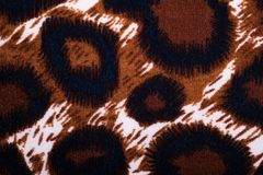 Closeup of native style material with leopard print design. For background or wallpaper royalty free stock photography