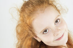 Closeup Natural Portrait of Little Red-haired Girl Looking Strai Stock Photos