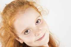 Closeup Natural Portrait of Little Red-haired Girl Looking Strai Stock Images