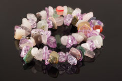 Closeup necklace from crystals of amethyst, fluorite, jasper and rose quartz Stock Photography