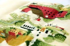 Closeup of needle put into cross-stitch embroidery Stock Photo