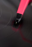 Closeup of needle scratching a spinning vinyl record Stock Images