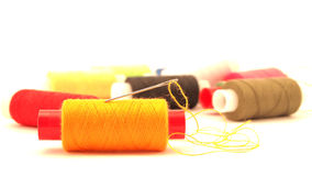 Yellow thread and needle Royalty Free Stock Photography