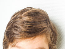 Closeup of a neet hairstyle on a young boy. Towards a white wall Royalty Free Stock Image