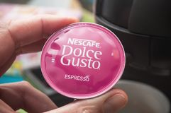 Closeup of Nescafe expresso, the french brand of coffee dose in hand. Mulhouse - France - 8 February 2018 - closeup of Nescafe expresso, the french brand of royalty free stock image