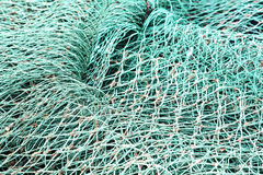 Closeup of netting. Fishing nets creates background of ropes and knots Stock Image