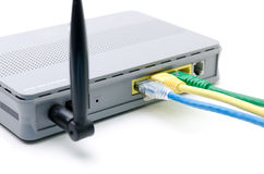 Closeup of network cables connected to wifi router Royalty Free Stock Photos