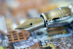 Closeup of a fountain pen on colorful paper Royalty Free Stock Image