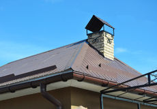 Closeup on new house rain gutter system and roof protection from snow board on house roofing Stock Photo