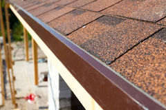 Closeup of new installed bitumen roof shingles stock photography
