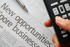 Closeup on new opportunities text and hand phone Royalty Free Stock Images
