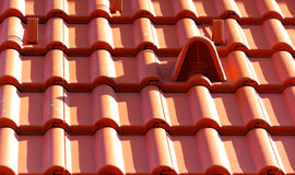 Closeup of new red roof tiles with aeration Royalty Free Stock Photography
