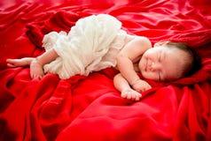 Newborn baby girl is sleeping on fur blanket royalty free stock photo