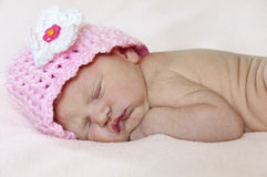 Closeup of newborn baby with pink hat. Closeup of newborn baby sleeping with pink knit hat royalty free stock photo
