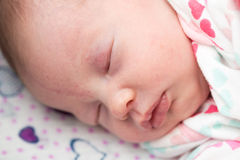 Closeup of a newborn baby sleeping in the crib, Royalty Free Stock Image