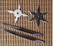 Ninja Star Shurikens with throwing spikes on Wooden Background,. Closeup Ninja Star Shurikens with throwing spikes on Wooden Background, Copy Space royalty free stock image